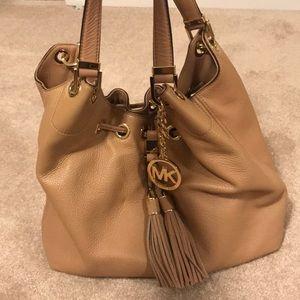 Michael Kors purse with tassel